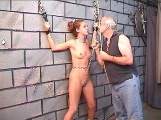 Nicole in bondage fastening devices catches spanked against brick wall