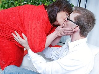 Check out this mature mistress making out with this natural gent
