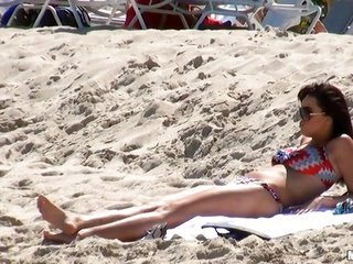 honey floozy was lying on the beach too straight off she is getting fucked right from behind