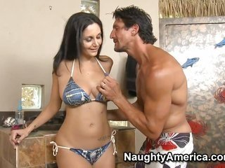 cute Ava Addams was attracted by Tommy Gunn to tan at his classy swimming pool